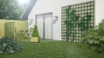 Kratka ogrodowa na elewacji budynku